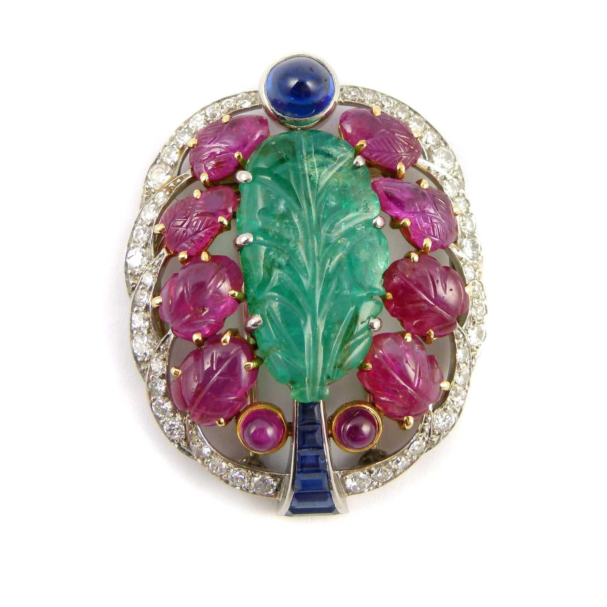 Art Deco carved emerald, ruby, sapphire and diamond brooch, French c.1925, workshop mark for Georges Lenfant who was a maker for Cartier