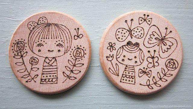 Wood-burnt kokechi doodles, by Happy Doodle Land
