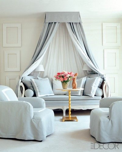 Soft blue and white settee and chairs with ciel de lit over the settee very serene