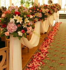 aisle decor- just the tulle, tied just above the seat part of the chair... minus the bouquets?