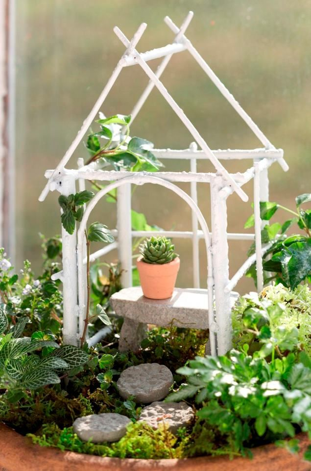 Fairy garden pole structure with tiny potted plant