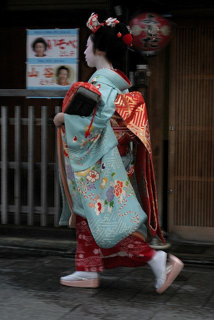 Sakiko as junior maiko by bycolley on Flickr She was wearing an amazing outfit - light blue kimono with Buddhists pattern and flowers made of shibori with rich orange and gold obi. Sakiko is now a geiko!