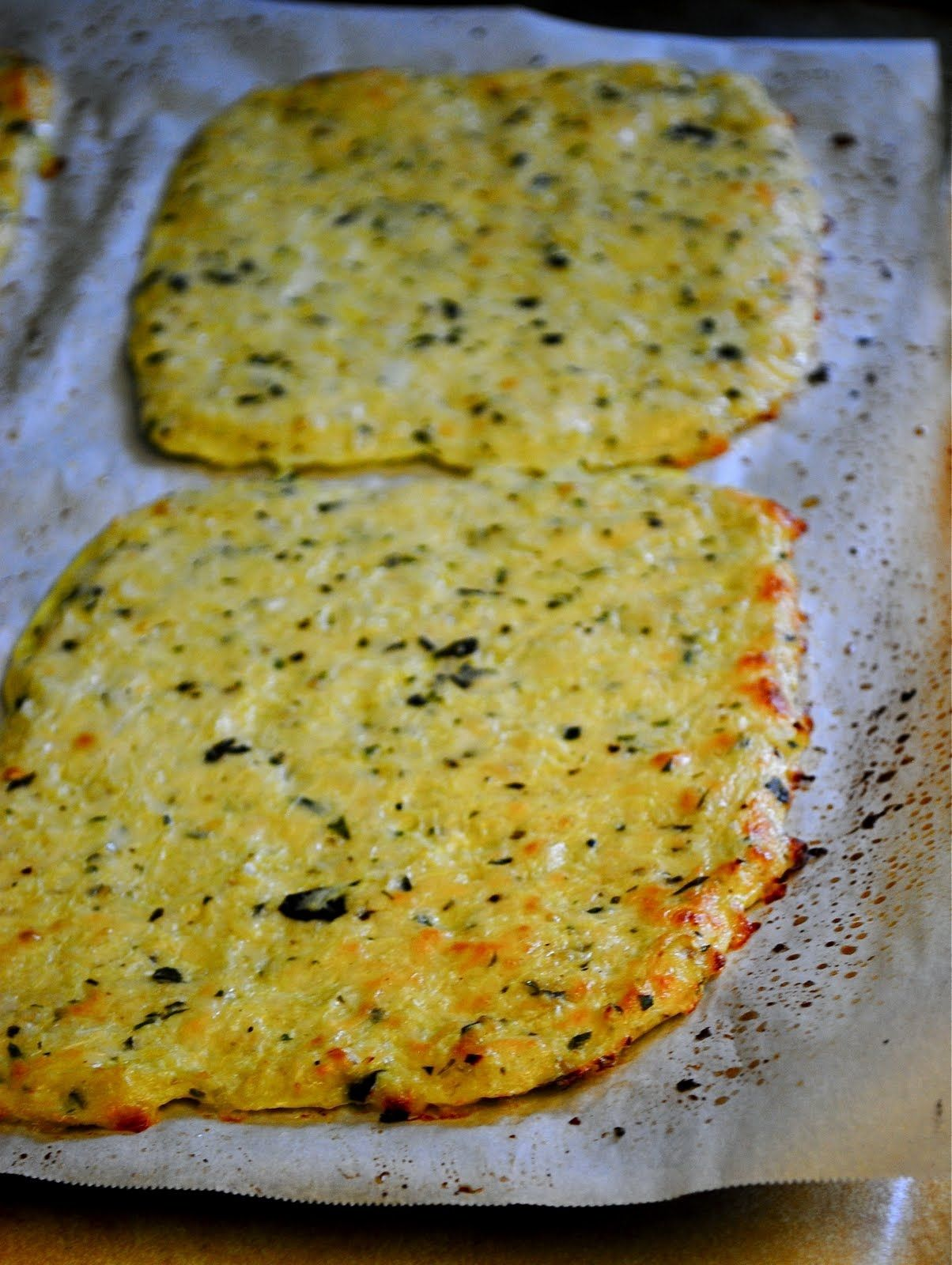Cauliflower Pizza Crusts (or bake just for cutting into pieces in order to eat low carb dips - would be an excellent replacement for bread!)