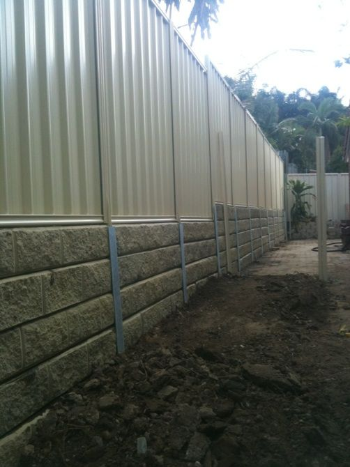 Pioneer Sandstone Effect In Natural Concrete Sleeper Retaining Wall The Colour Bond Fence Has B Concrete Sleeper Retaining Walls Dream Backyard Retaining Wall