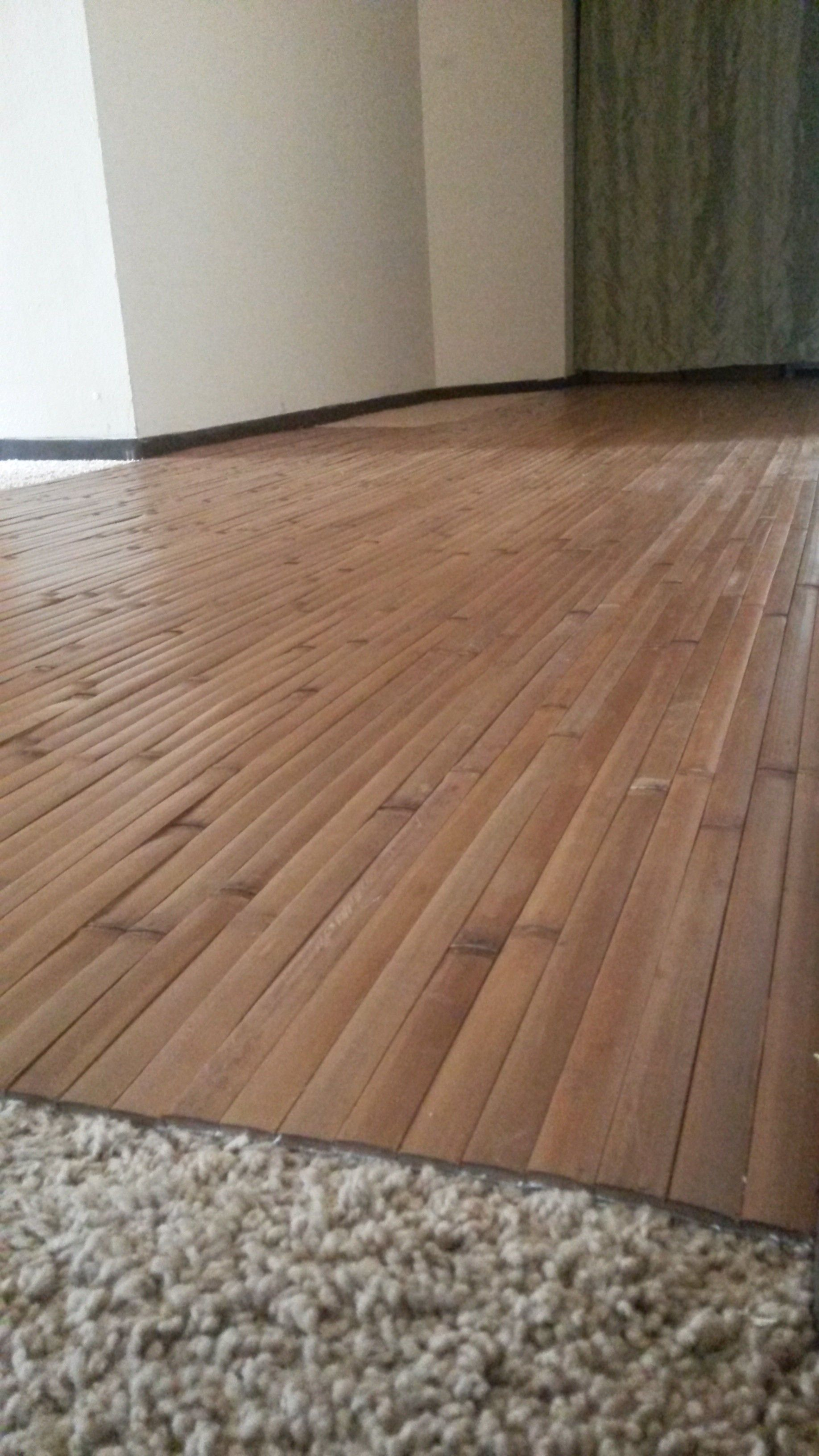 Laying Wood Floor Over Carpet