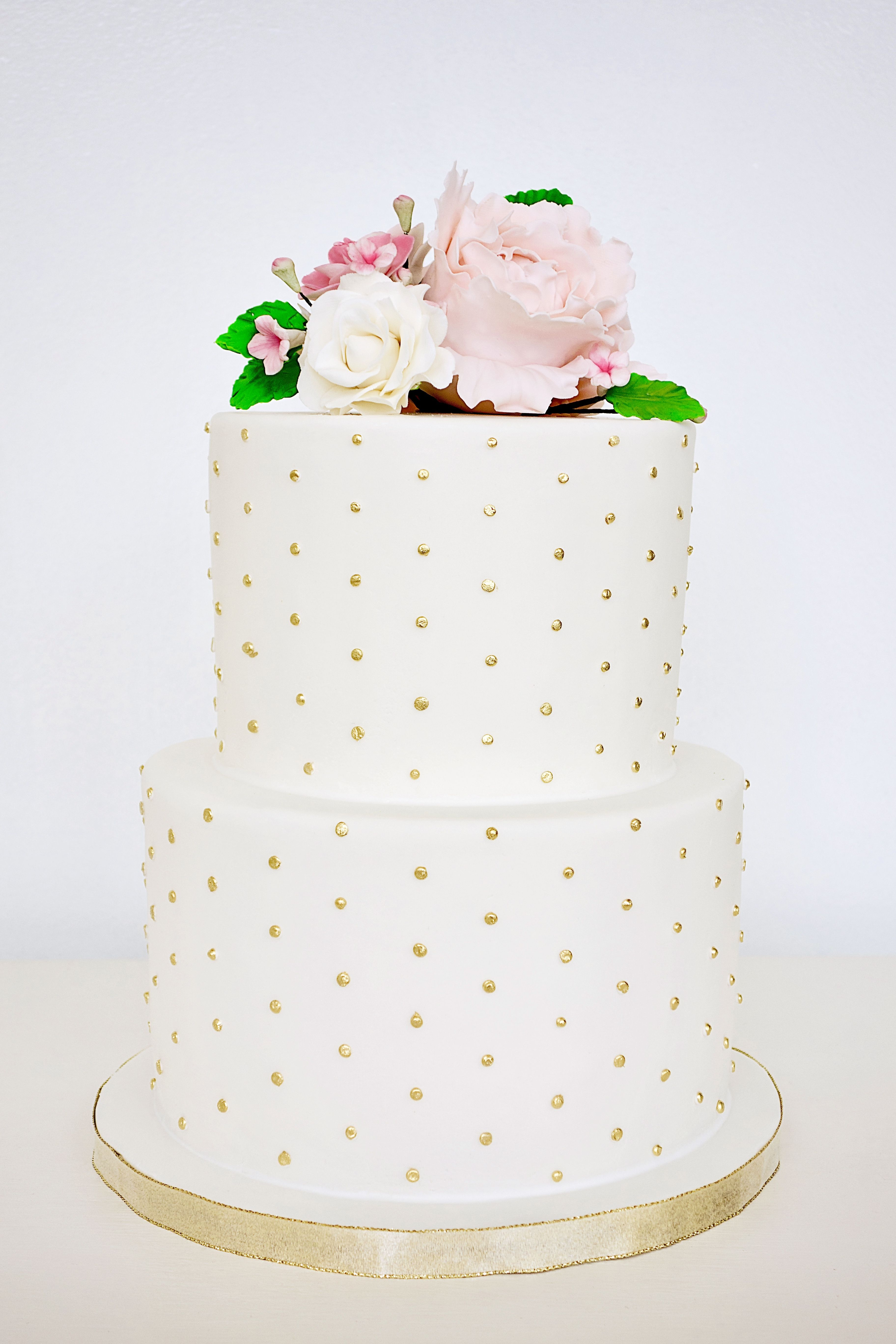 White And Gold Polka Dot Fondant Cake Topped With Pink Sugar