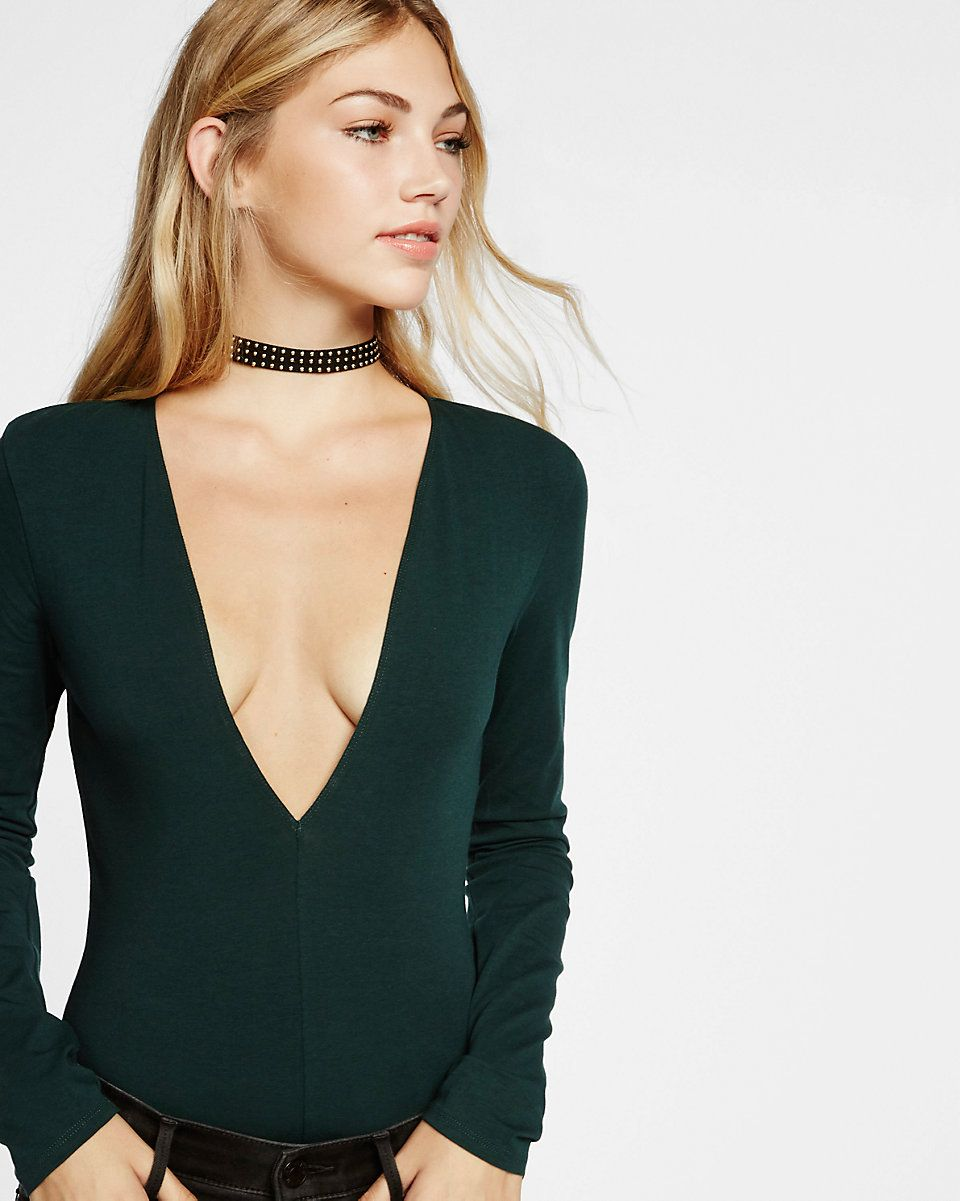 c9ff0900ab This soft thong-cut bodysuit gives you a dramatic deep v neckline with  stay-put security below. Pair it with a mini skirt and strappy heels for a  drop dead ...