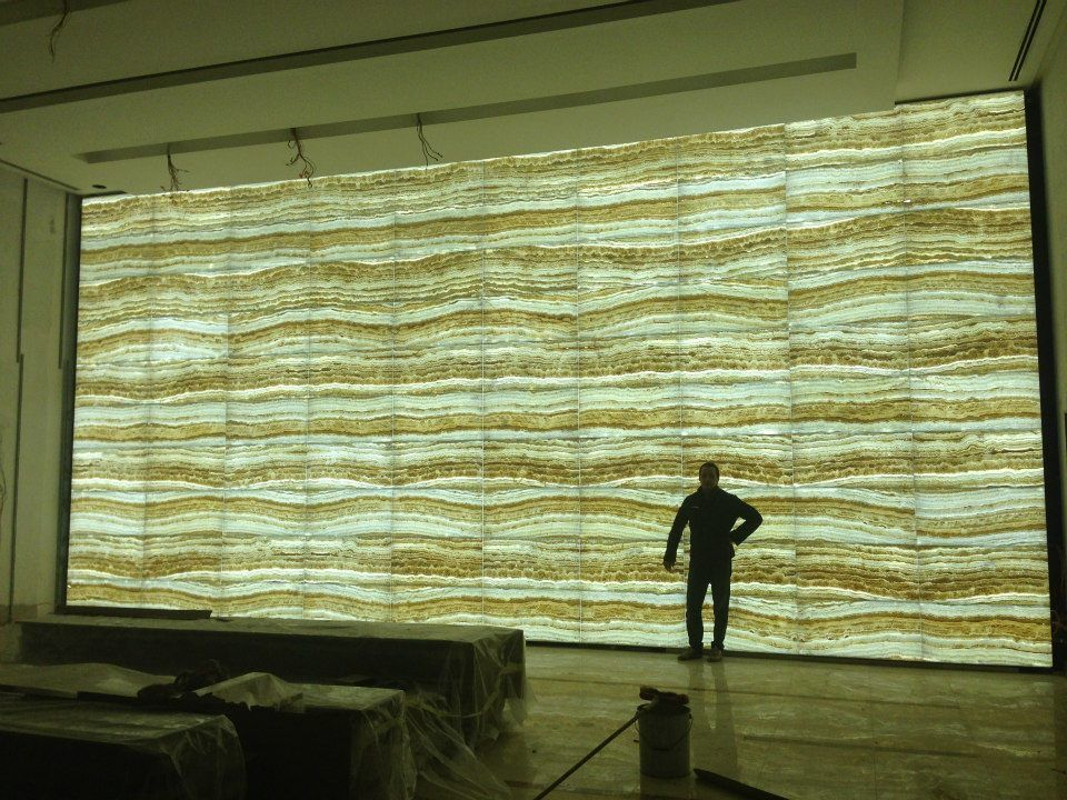 """The backlit """"Jastone"""" wall, made by JANUSITALIA.  UAE Embassy, Jordan"""