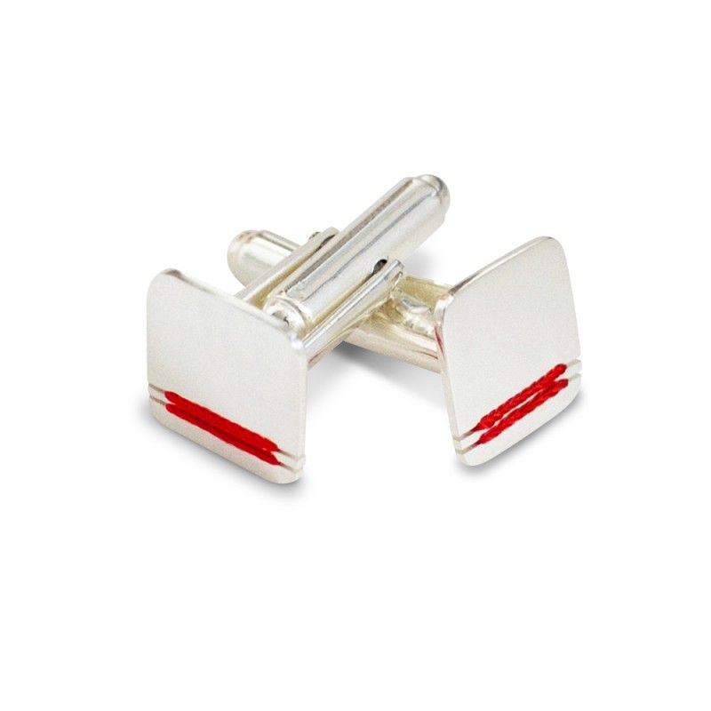 An exclusive creation from Donum Paris.  This is the ultimate fashion accessory for a man's wardrobe. Created by hand, these silver cufflinks are elegant and original.  These unique cufflinks from Donum are made of silver with a silk thread detail placed carefully by hand on the top.  Give a truly refined look to your suit. #BestMan #Personalized #Groomsmen #madeinfrance #Paris #France #mode #faitmain #red