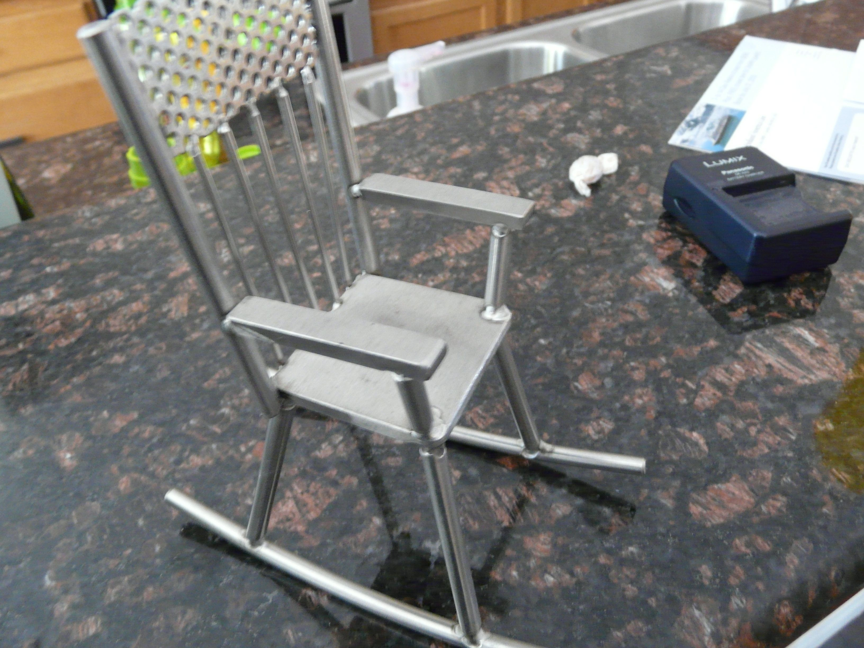 8inch Tall Stainless Steel Rocking Chair. Www.newaiw.com