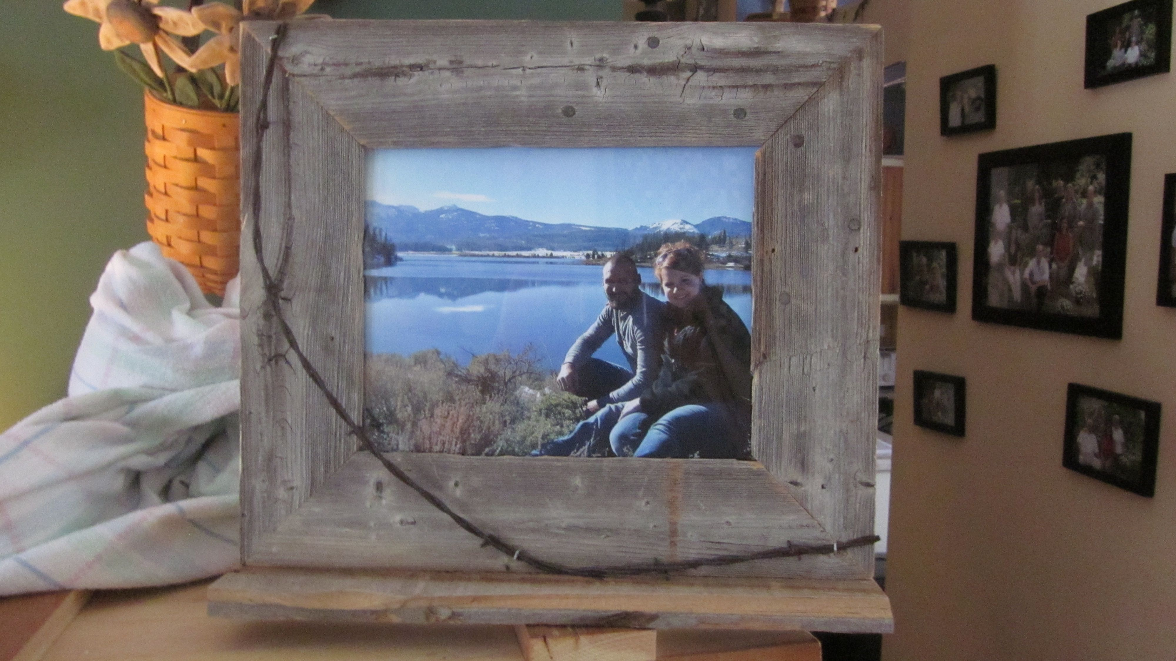 frame for Jamie from 120+ barn wood and railroad barbed wire from the early 1900's