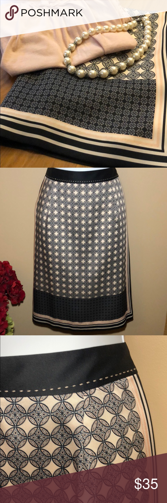 """ANN TAYLOR Mediterranean Style Skirt ANN TAYLOR NWOT Beautifully patterned skirt with blush threading over navy waistband. Pattern reminds me of a Mediterranean tile or tapestry.  Flowy/Lined.  Slit/Zipper in back.    Navy, cream, blush.   Approx 31"""" waist (meas all the way around w fabric tape).  Just over 15"""" across. 23"""" long @side. Smoke-free home.   TINY blue dot on the edge of the navy/cream line at bottom side of skirt...ink run? Only noticed while taking pics. See 2nd pic. I don't think anyone would notice it but me!"""