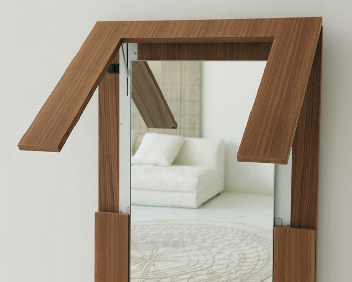 Mesa de comedor plegable es también espejo de pared, por Porada ...