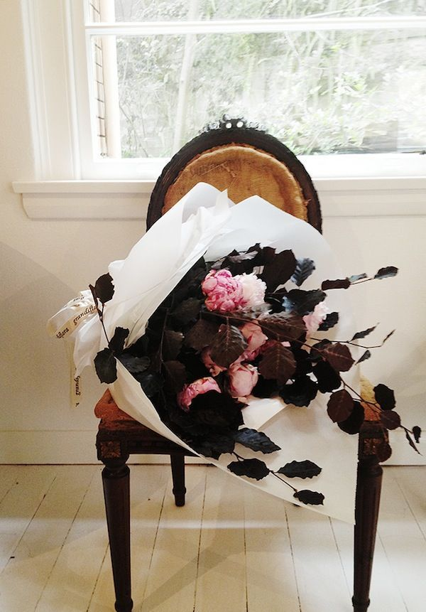 dark leaves + peonies.  @thecoveteur