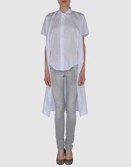 Love this white Margiela blouse w/ tail