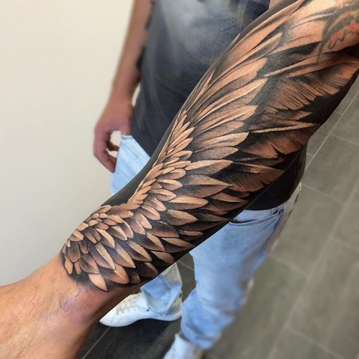 1001  cool and inspiring wing tattoo designs and their praises  tattoo angel wing man with 3d tattoo on forearm realistic wing