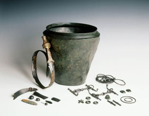 Funerary gifts found in a royal tomb. A bronze situla (urn) held a sword, horse equipment and various tools.  Oss, the Netherlands, ca. 800-500 B.C.