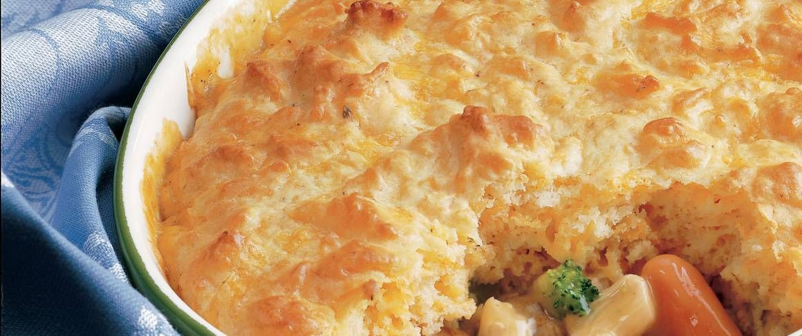 A mouth-watering mixture of creamy chicken and veggies bubbles underneath a golden brown biscuit topping.