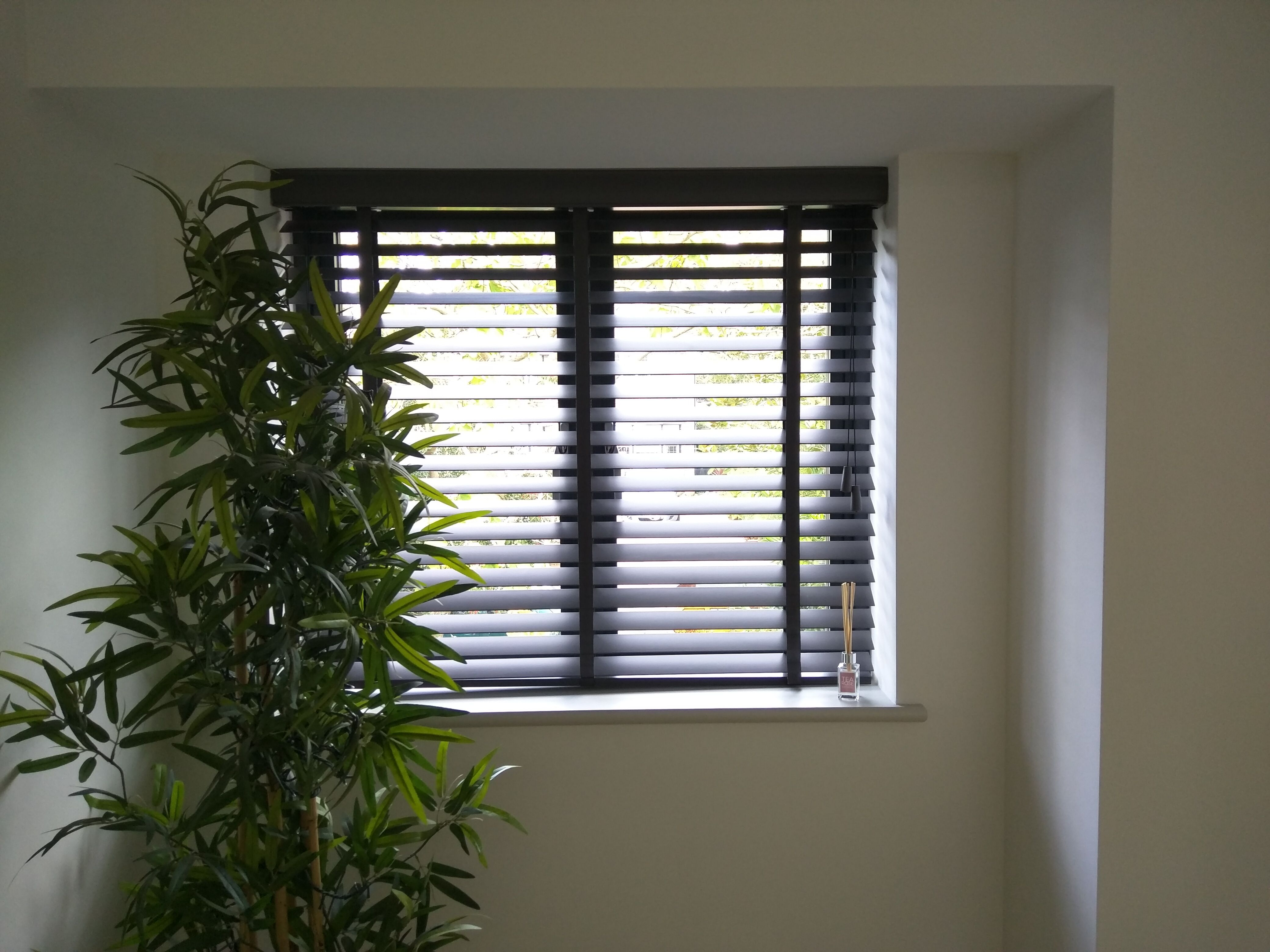 Wood venetian blind with tapes blind fitted inside window recess
