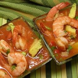 Cooked shrimp are chilled in a spicy tomato-juice cocktail with avocado, red onion, and cilantro.