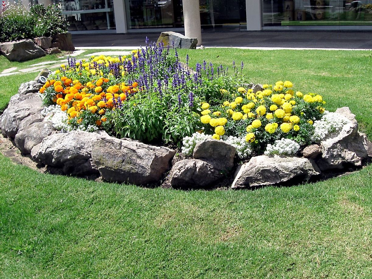 Flower bed with rock contour correct flower beds for for Images of landscaping flower beds