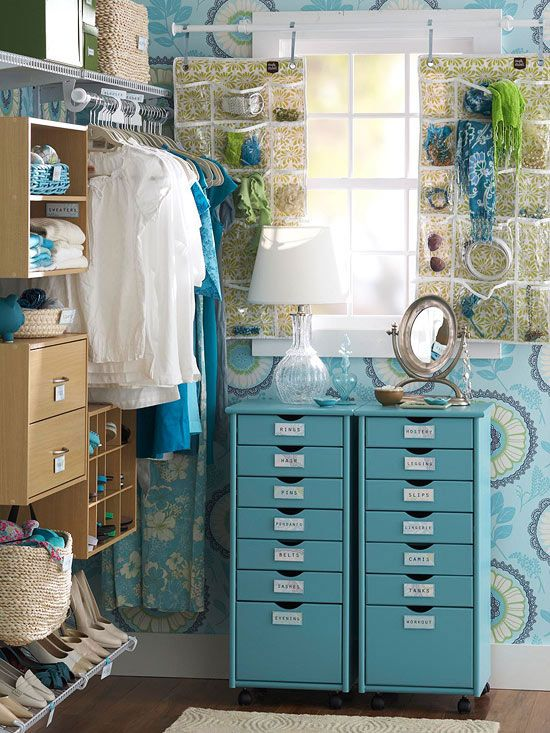 Head-to-Toe Convenience On the narrow end wall of this storage-packed closet, two rolling storage carts keep smaller items, such as undergarments and tanks, in check. The tops of the carts function as a petite dressing table for a final check before heading out.