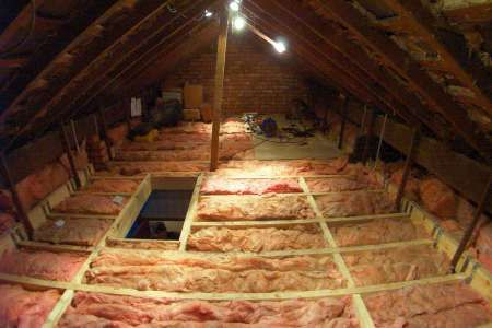 the floor joists sitting level in their joist hangers insulation