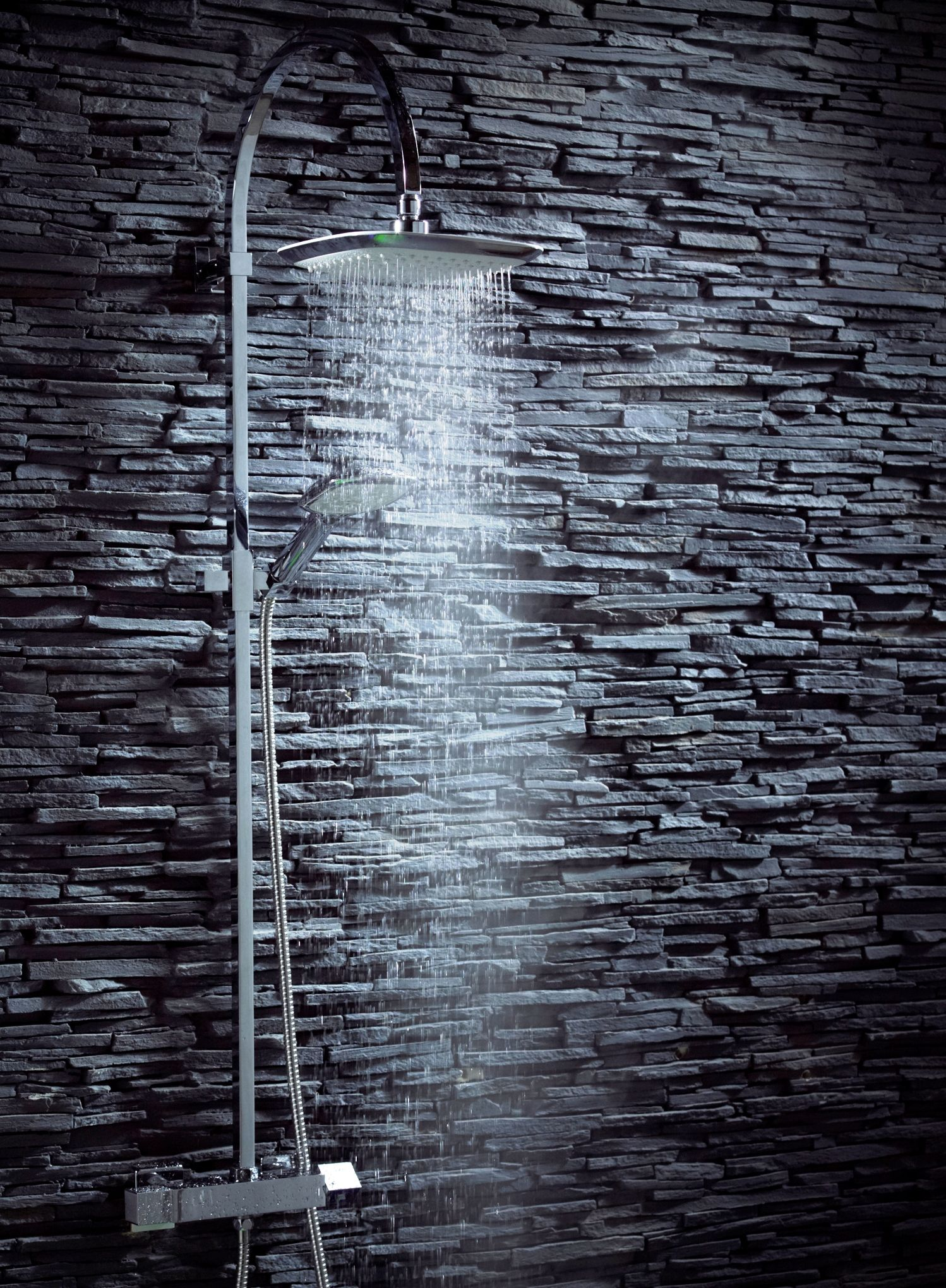 Combine a contemporary shower with a dark backdrop for an edgy look ...