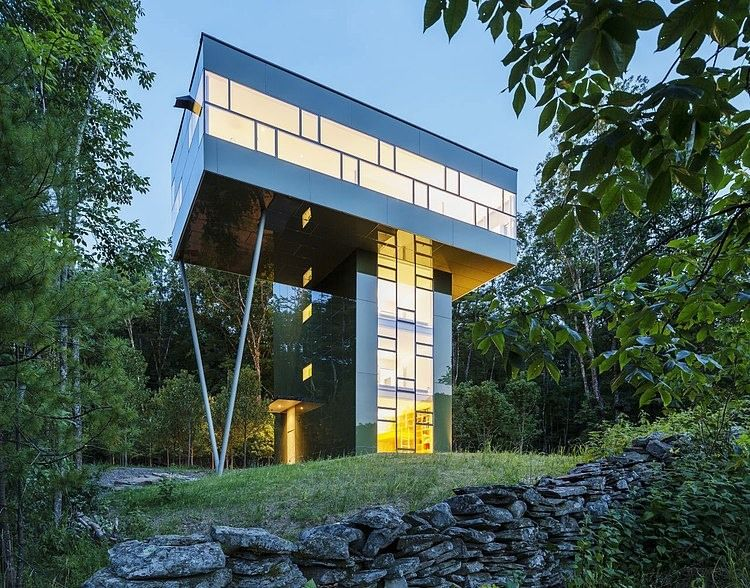 Designed by Gluck+ , this #modern vacation #home surrounded by forest is situated in Upstate New York.