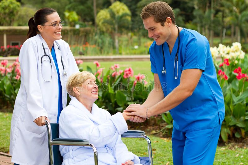Nurse meet patient. Friendly male nurse meet happy senior