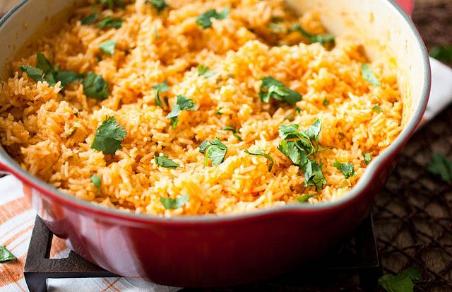 Mexican Rice. 2 tomatoes, 2 shallots, 2 cups rice, rinsed, 6 cloves of garlic, minced, 2 jalapenos, minced, 2 cups chicken stock, 2 tbsp tomato paste, 1 tsp salt. Core tomatoes and add with shallots to food processor. Saute rice in pot and cook until toasted. Add garlic and jalapenos, stir for 5 min. Add tomatoes and shallots, stock, tomato paste, and salt. Bring to boil. Cover and put in 325 oven for 15 min. Stir and return to oven until finished, 15-20 min.
