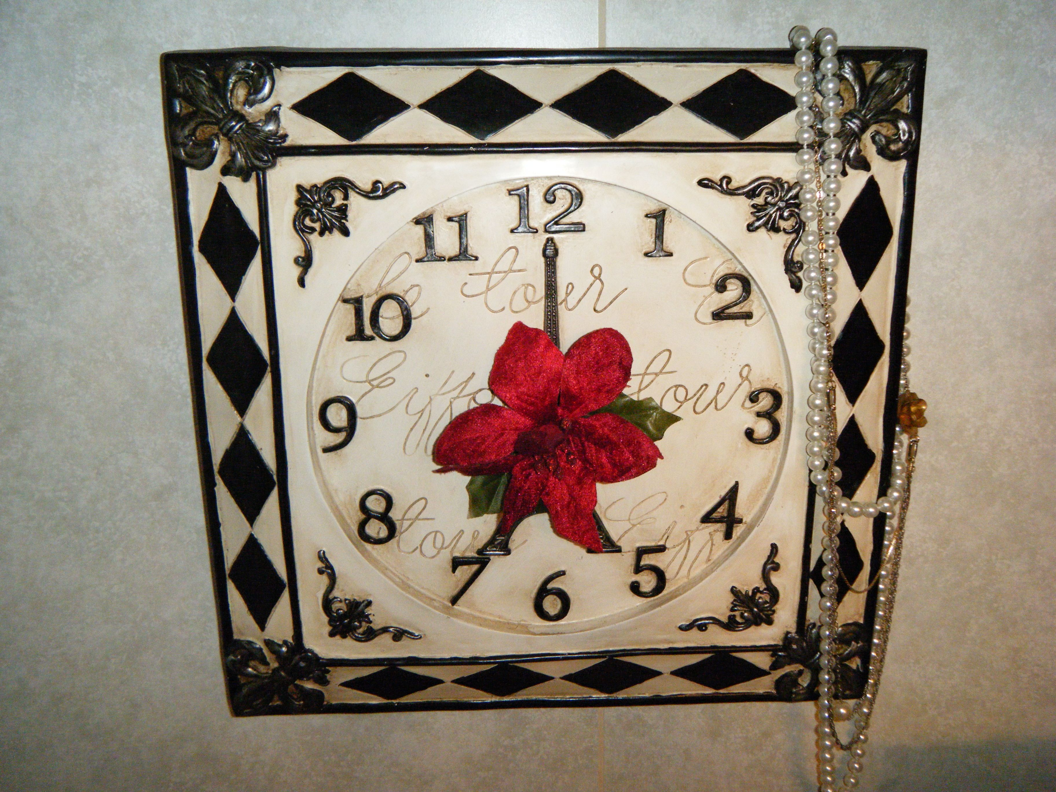 found this old clock at a yard sale awhile back, wasn't working of course so i added a few extra touches to make it my own and I love it!