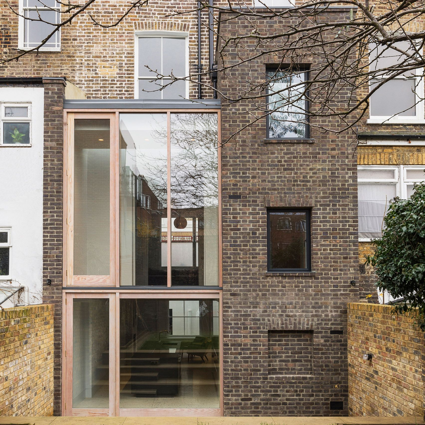 Contemporary London Home: A Brick Tower And A Glass Volume Form An Extension By