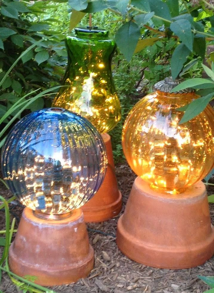 Diy Garden Lights Made From Flower Pots And Old Lamp Globes With Strings Of White