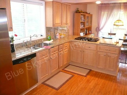Hill Maple Kitchen Cabinets With Light Colored Granite Countertop