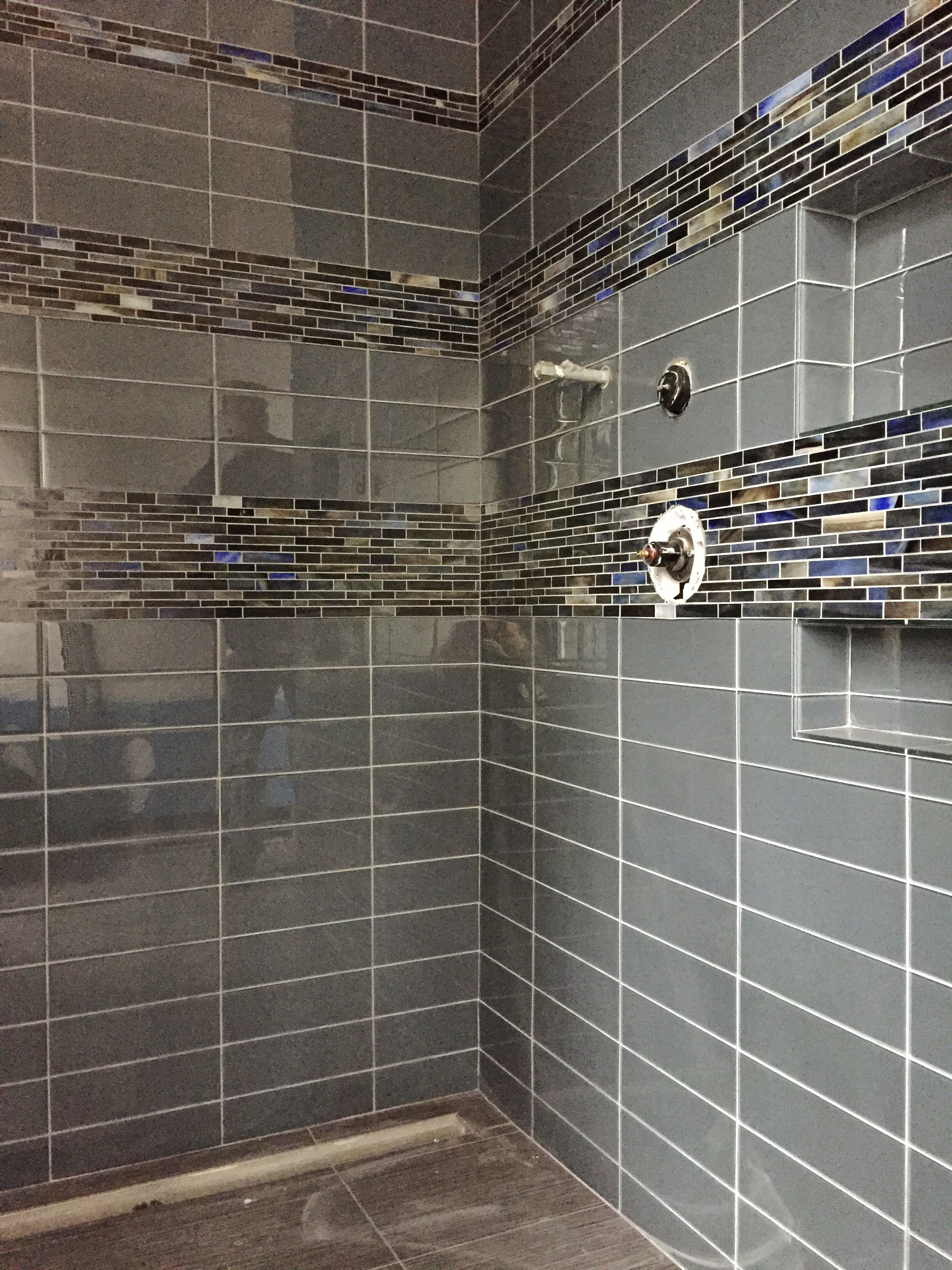 4x12 Glass Tile With Glass Accent Band Around Shower Linear Drain At Floor Daniel Island Sc Tile Layout Master Bath Tile Installing Hardwood Floors