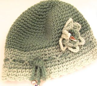 Crocheted cloche hat with charms.