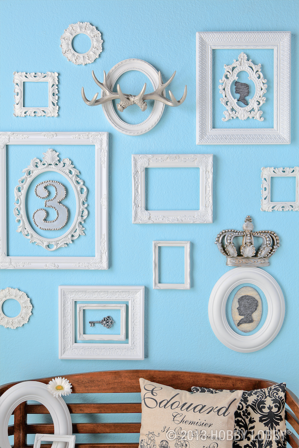 An assortment of frames painted the same color will keep this ...