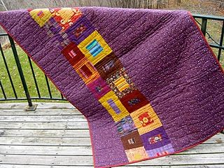 This back is one length of fabric split combined with leftover blocks.  It makes a graphic statement.