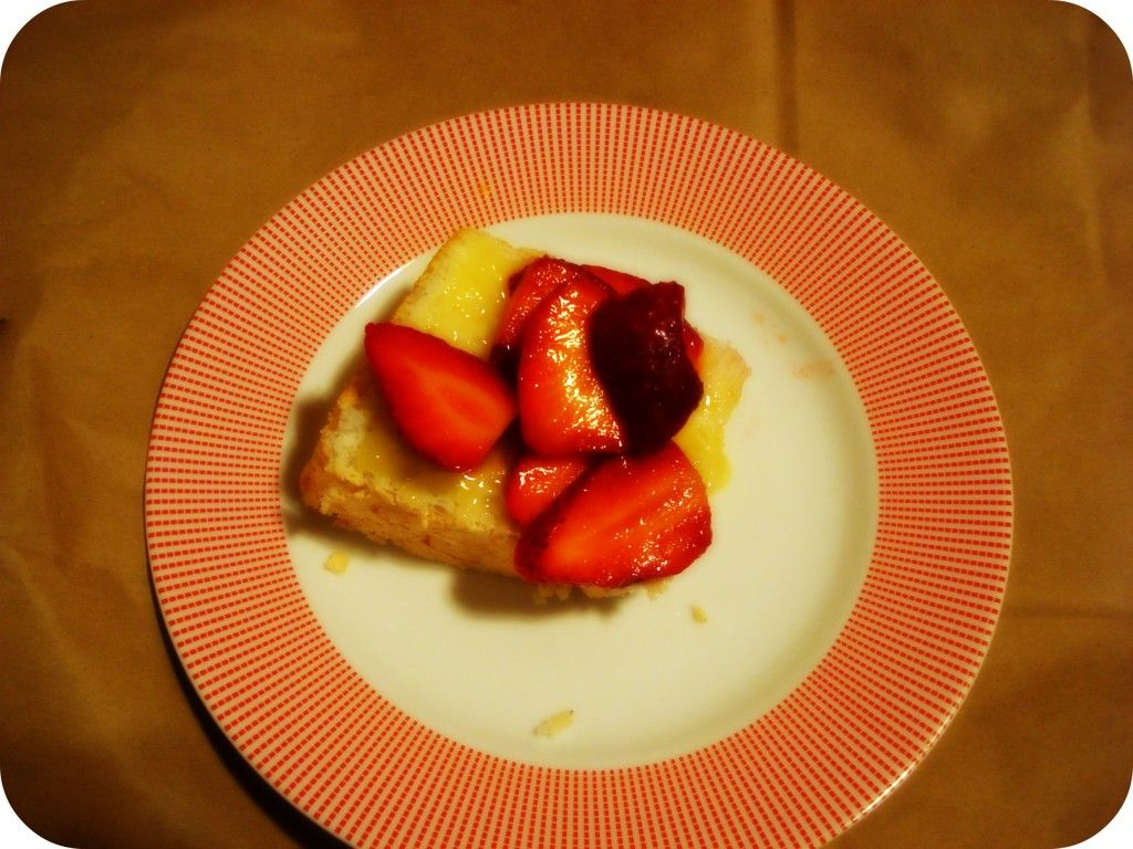 Homemade angel food cake with lemon curd and berries