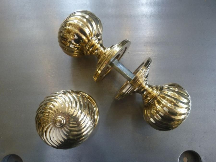 Reclaimed, highly polished solid brass door knobs with a swirl ...