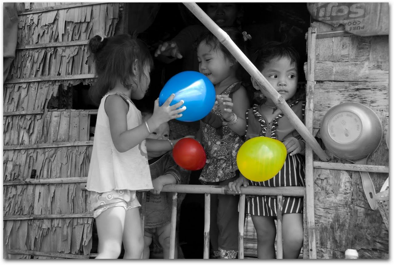 Cambodian children with balloons.