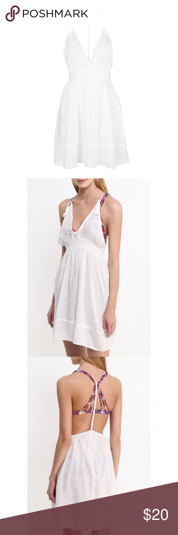 TOPSHOP Smock Tassel Sundress Perfect for complimenting sun-kissed skin, this sundress comes in a crisp white hue. Detailed with a scooped v-neckline, it's finished with a strappy design to the back with cute tassels to the shoulder. Perfect styled with sandals and a hat as the weather warms. 100% Viscose. Machine wash. Topshop Dresses Mini