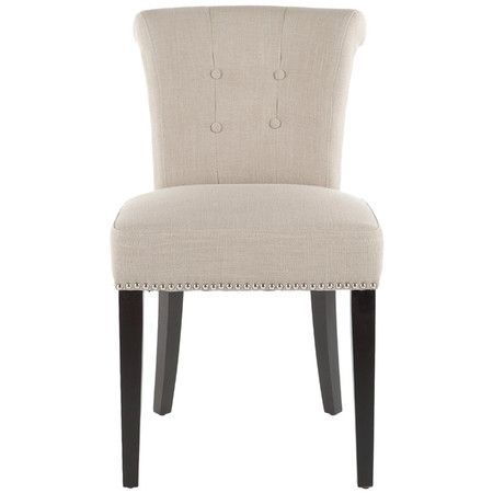 Perfect pulled up to your dining table or writing desk, this classic side chair showcases a scrolled back and nailhead trim.    Product:...