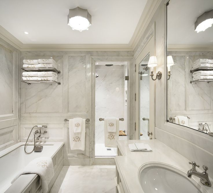 Awesome Stunning Bathroom Features Marble Paneled Walls Used As Backdrop To Paneled  Bathtub Paired With Wall Mounted Tub Filler Situated Under Train Rack Next  To ...