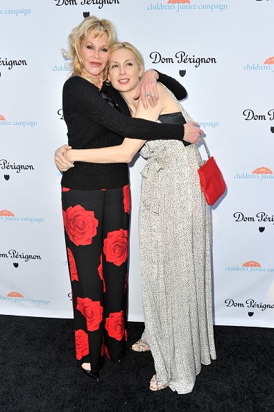 Actress Melanie Griffith and actress Kelly Rutherford attend Children's Justice Campaign Event on May 12 2015 in Beverly Hills California