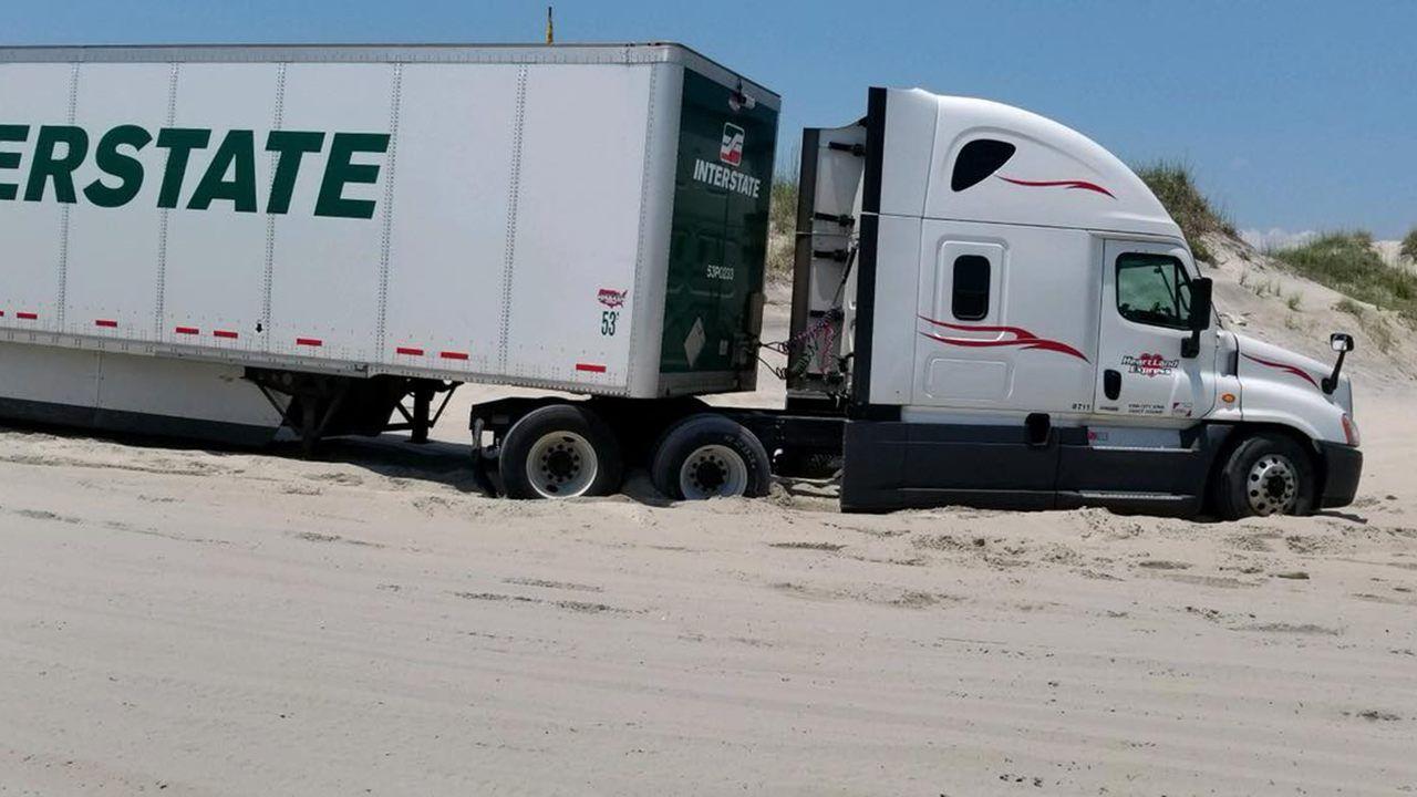Semi-truck gets stranded on North Carolina beach after GPS ...