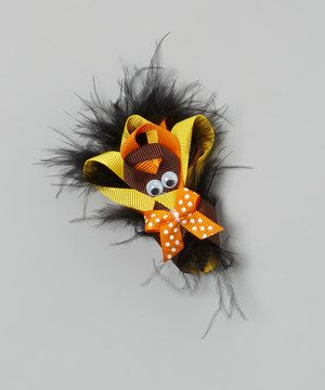 Add festive fall flair to any hairdo with this perky turkey. A sturdy clip in back slides into tresses and stays put, so this playful piece can share its silly splendor all day long.