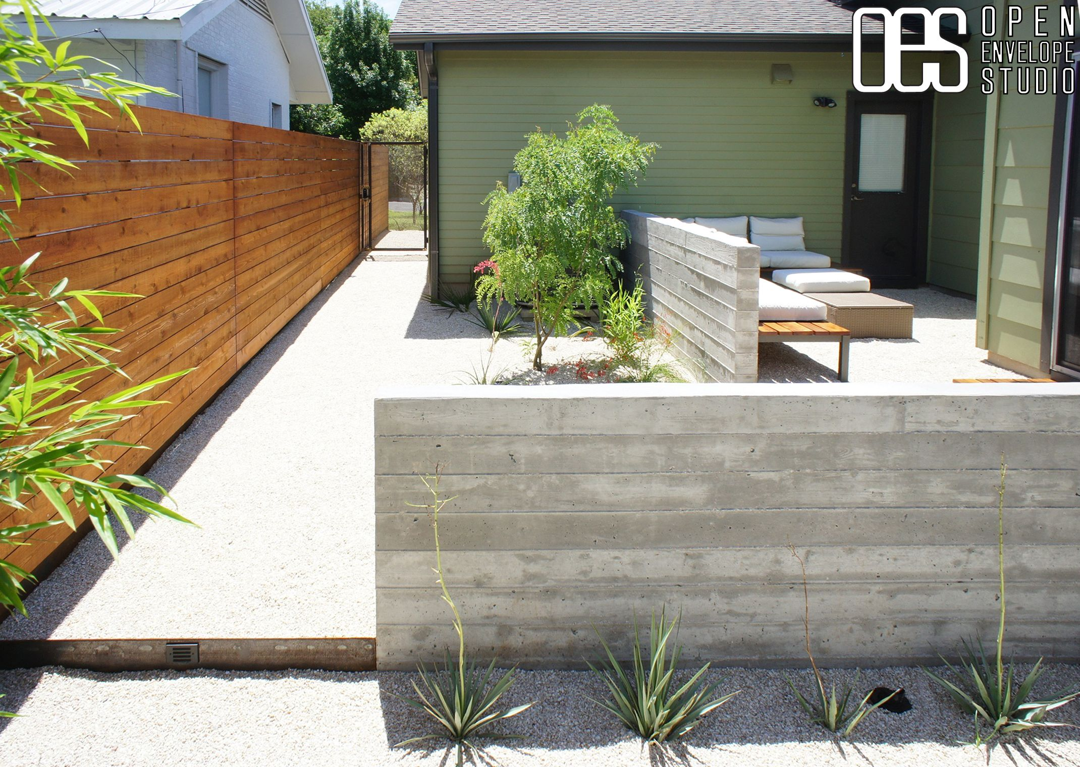 Oes Wilson Residence Board Form Concrete Walls Custom Bench Horizontal Fence Front Courtyard Modern Landscaping Concrete Retaining Walls