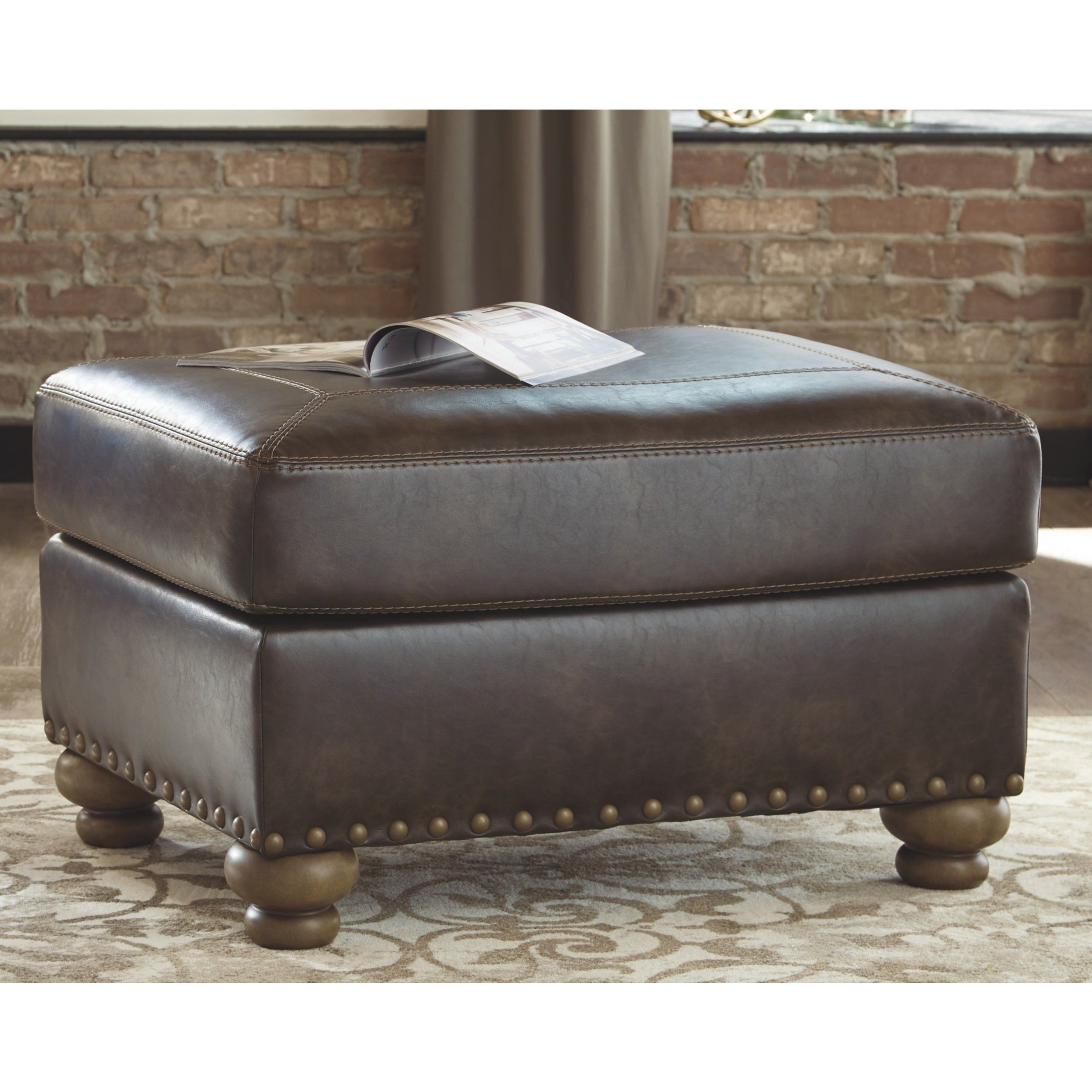Signature Design By Ashley Nicorvo Brown Faux Leather Ottoman In